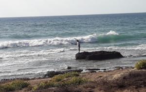 דייג בחוף שבי ציון